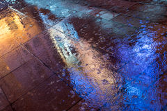 Neon reflections on sidewalk Stock Images