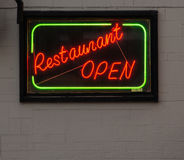 Neon 'Restaurant Open' Sign. A neon sign, signifying an open restaurant Stock Images
