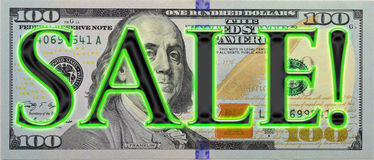 Neon SALE! on new $100 bill. The new $100 bill with the word sale in capital letters and outlined in neon green.  Expanded 175% of normal size to comply with US Royalty Free Stock Photo