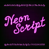 Neon script hand drawn alphabet font. Purple neon type letters and numbers on a dark background. Vector typeface for labels, titles, posters etc Royalty Free Stock Images