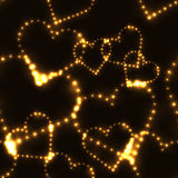 Neon shinning gold hearts on dark background Royalty Free Stock Photography