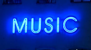 Neon sign. Music at night Stock Images