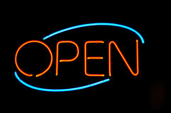 Neon sign. Typical Open diner and restaurant neon sign welcoming and inviting guests to come in Stock Images