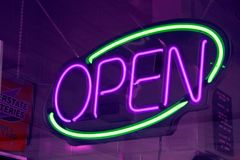 Neon Sign. Purple and green neon sign Royalty Free Stock Photography