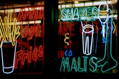 Neon Sign 3. Neon signs in the window of a restaurant stock photography