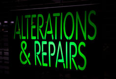 Neon Sign Alternation and Repairs. On Black Background Royalty Free Stock Photography