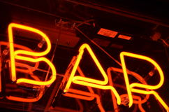 Neon sign of bar. Neon sign of a bar. Seen in London at night Stock Photos