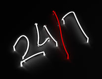 24 / 7 neon sign on black background Royalty Free Stock Photo