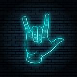 Neon sign with blue glow. Hand gesture, rock n roll. On a brick wall background, for your design stock illustration