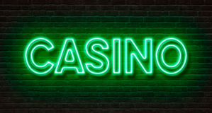 Neon sign on a brick wall - Casino Royalty Free Stock Photos