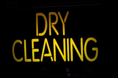Neon Sign Dry Cleaning. On Black Background Stock Photo