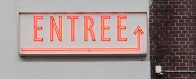 Neon sign - entree stock photo