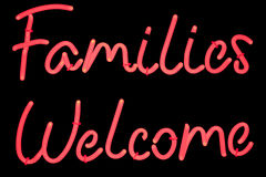 Neon sign - Families Welcome. A fluorescent neon sign stating that Families are Welcome Royalty Free Stock Photography