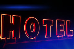 Neon sign Hotel at night Stock Image