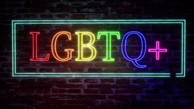 Neon sign with the inscription LGBTQ plus on a brick wall background. Colorful pride design. Quote lettering. Rainbow