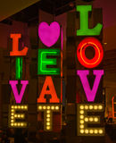Neon sign; live, eat, love. Stock Photo