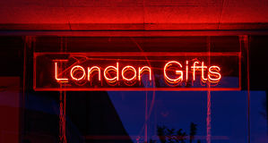 Neon Sign London Gifts. Red neon sign of the words London Gifts stock image