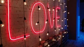 The neon sign of `Love`. Neon love royalty free stock photography