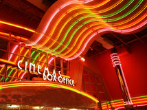 Neon sign at movie theater. Retro glowing neon lights at movie theater box office Stock Photo