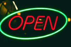 Neon sign. `Open` at night, round the clock work, advertising business restaurant Stock Image
