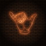 Neon sign with an orange glow. Hand gesture, shaka. little finger and thumb. On a brick wall background, for your design vector illustration