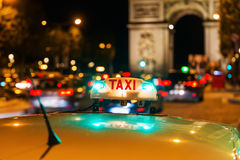 Neon sign of a Parisian taxi Stock Images