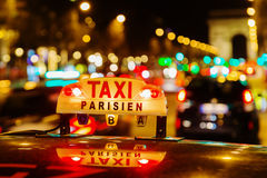 Neon sign of a Parisian taxi Royalty Free Stock Images