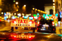 Neon sign of a Parisian taxi Royalty Free Stock Image