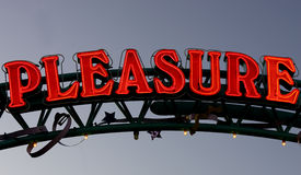Neon sign pleasure. Horizontal Stock Photography