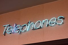 Neon sign reading Telephones Royalty Free Stock Photo