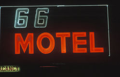 A neon sign that reads �66 Motel vacancy� Stock Image