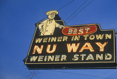 A neon sign that reads �Best Weiner in Town, Nu Way Weiner Stand� Stock Photo