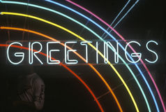 A neon sign that reads �Greetings� in Los Angeles, California Stock Image