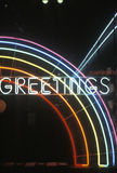 A neon sign that reads �Greetings� in Los Angeles, California Stock Photography