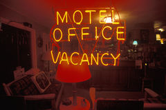 A neon sign that reads �Motel office, Vacancy� Stock Images