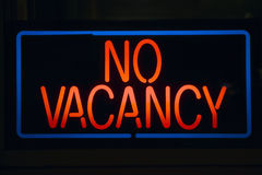 Neon sign reads �No Vacancy� for a motel at night Stock Photo