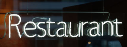 Neon sign - Restaurant. Illuminated neon sign Restaurant in a window Stock Photography