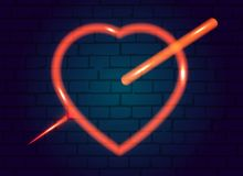 Neon sign. Retro neon sign of the heart against a brick wall. Stock Photos