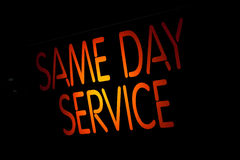 Neon Sign Same Day Service. On Black Background Royalty Free Stock Photos