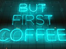 A neon sign that say `but first coffee`. A blue neon sign showing the words `but first coffee` with square tiles in the background stock photo