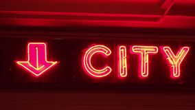 Neon sign saying CITY red nightlife straight on shot. Neon sign saying CITY nightlife. Red and orange stock footage
