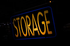 Neon Sign Storage. On the Black Background Royalty Free Stock Photos