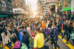 Neon signboards in Hong Kong. HONG KONG - FEBRUARY 12,2015: people crossing Nathan Road. Hong Kong is well known for the myriad of neon lights located above the Royalty Free Stock Image