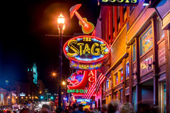 Neon signs on Lower Broadway Nashville. NASHVILLE - NOV 11: Neon signs on Lower Broadway Area on November 11, 2016 in Nashville, Tennessee, USA Royalty Free Stock Photography