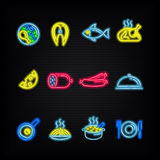 Neon signs. The symbols of different food. Neon signs. The symbols of different food, fish and meat on a dark background Stock Image