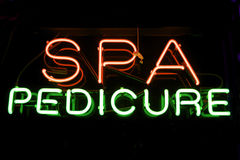 Neon Spa Pedicure sign. Red and Green SPA PEDICURE Sign lights up the night Royalty Free Stock Photography