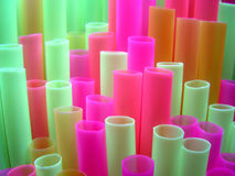 Neon Straws. Bright coloured drunking straws royalty free stock images
