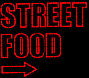 Neon Street Food Sign. Red Neon Street Food Sign with Arrow Royalty Free Stock Photography