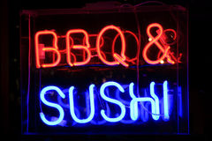 Neon Sushi And Barbecue Sign Royalty Free Stock Photography