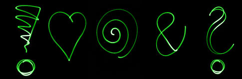 Neon symbols. Different flourescent symbols in green neon color Stock Photography